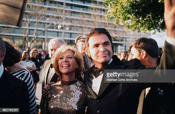 Entertainer Dinah Shore and actor Burt Reynolds arrive to the 46th Academy Awards at Dorothy Chandler Pavilion in Los AngelesCalifornia