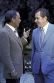Entertainer Frank Sinatra chatting with President Richard Nixon at a GOP celebrity fundraising event at Nixon's home