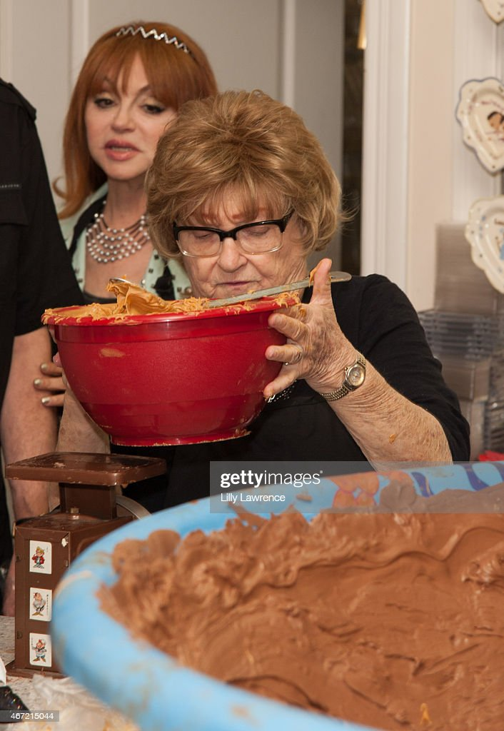 Entertainer Judy Tenuta watches as an employee of The Candy Factory weighs peanut butter to attempt World Record for The World's Largest Peanut Butter Cup at The Candy Factory on March 21, 2015 in North Hollywood, California.