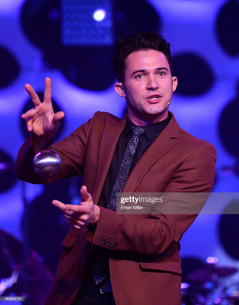 Entertainer Justin Willman performs a magic trick as he hosts the 13th annual Michael Jordan Celebrity Invitational gala at the ARIA Resort & Casino at CityCenter on April 4, 2014 in Las Vegas, Nevada.