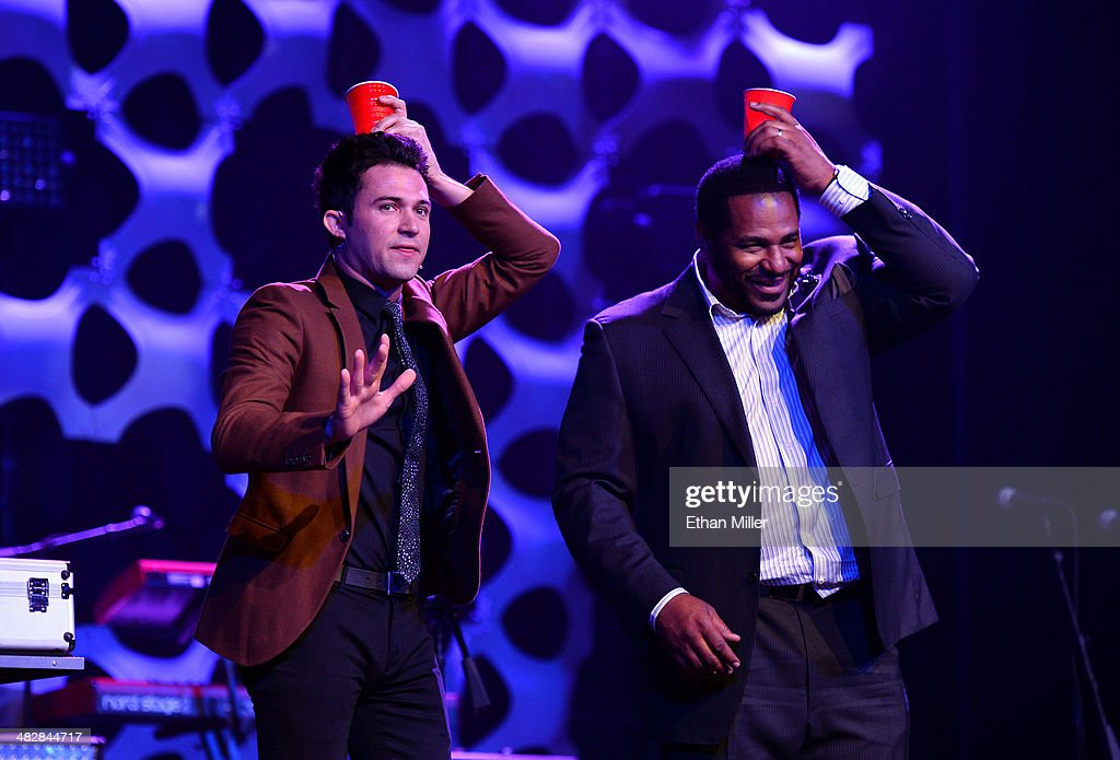 Entertainer Justin Willman (L) performs a magic trick with former National Football League player <a gi-track='captionPersonalityLinkClicked' href=/galleries/search?phrase=Jerome+Bettis&family=editorial&specificpeople=202820 ng-click='$event.stopPropagation()'>Jerome Bettis</a> at the 13th annual Michael Jordan Celebrity Invitational gala at the ARIA Resort & Casino at CityCenter on April 4, 2014 in Las Vegas, Nevada.