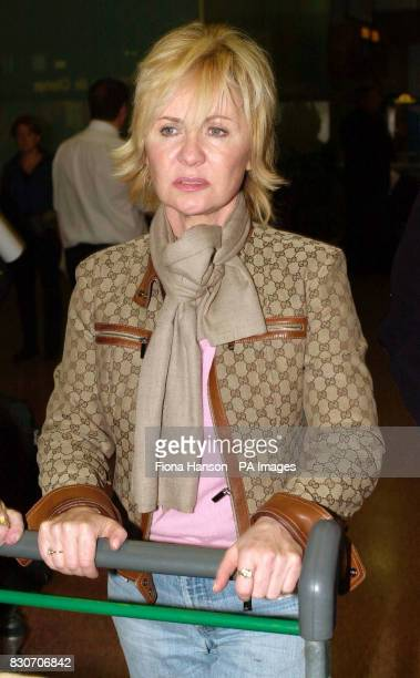 Entertainer LuLu at Heathrow airport after arriving from New York The singer was close to tears as she returned to the UK on the first British...
