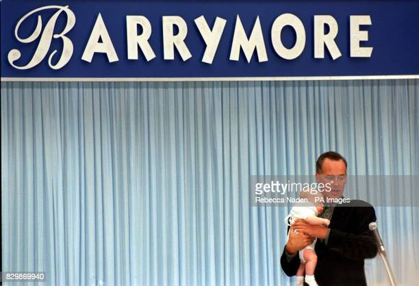 Entertainer Michael Barrymore performs with 11weekold Scott McClinton from Carshalton in Surrey as he records the first in a new series of his...