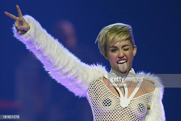 Entertainer Miley Cyrus winks and sticks out her tongue as she performs during the iHeartRadio Music Festival at the MGM Grand Garden Arena on...