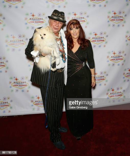 Entertainer Monti Rock III and his dog Zozo pose with singer Linda Suzanne at the debut of Suzanne's show 'Linda Suzanne Sings Divas of Pop' at the...