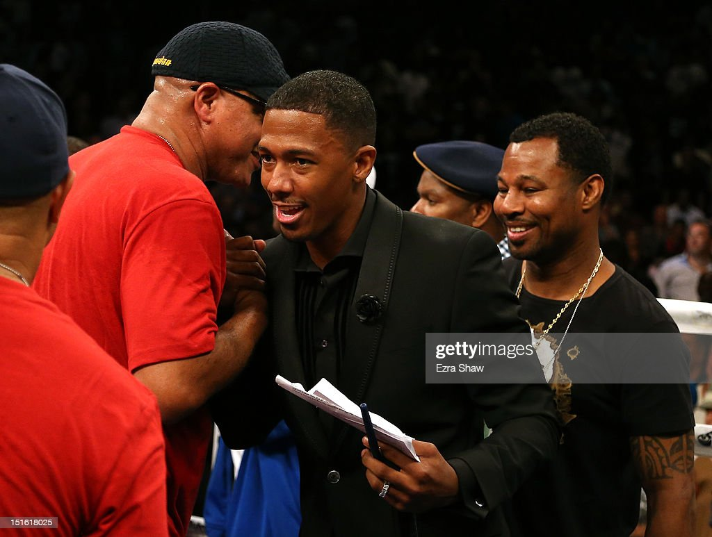 Entertainer <a gi-track='captionPersonalityLinkClicked' href=/galleries/search?phrase=Nick+Cannon&family=editorial&specificpeople=202208 ng-click='$event.stopPropagation()'>Nick Cannon</a> and boxer Sugar Shane Mosley (R) shakes hands with people in the ring after the Andre Ward-Chad Dawson WBA/WBC Super Middleweight championship fight at ORACLE Arena on September 8, 2012 in Oakland, California. Ward won by TKO in the 10th round.