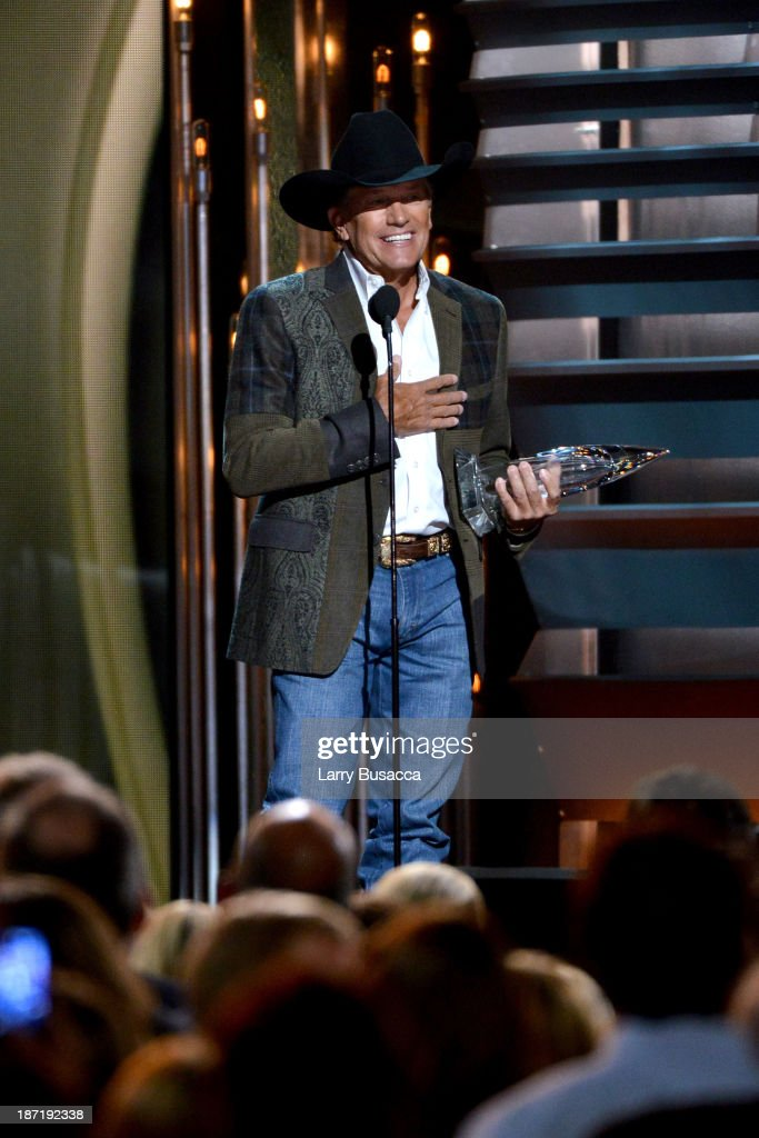 Entertainer of the Year award winner <a gi-track='captionPersonalityLinkClicked' href=/galleries/search?phrase=George+Strait&family=editorial&specificpeople=234588 ng-click='$event.stopPropagation()'>George Strait</a> speaks onstage during the 47th annual CMA awards at the Bridgestone Arena on November 6, 2013 in Nashville, United States.