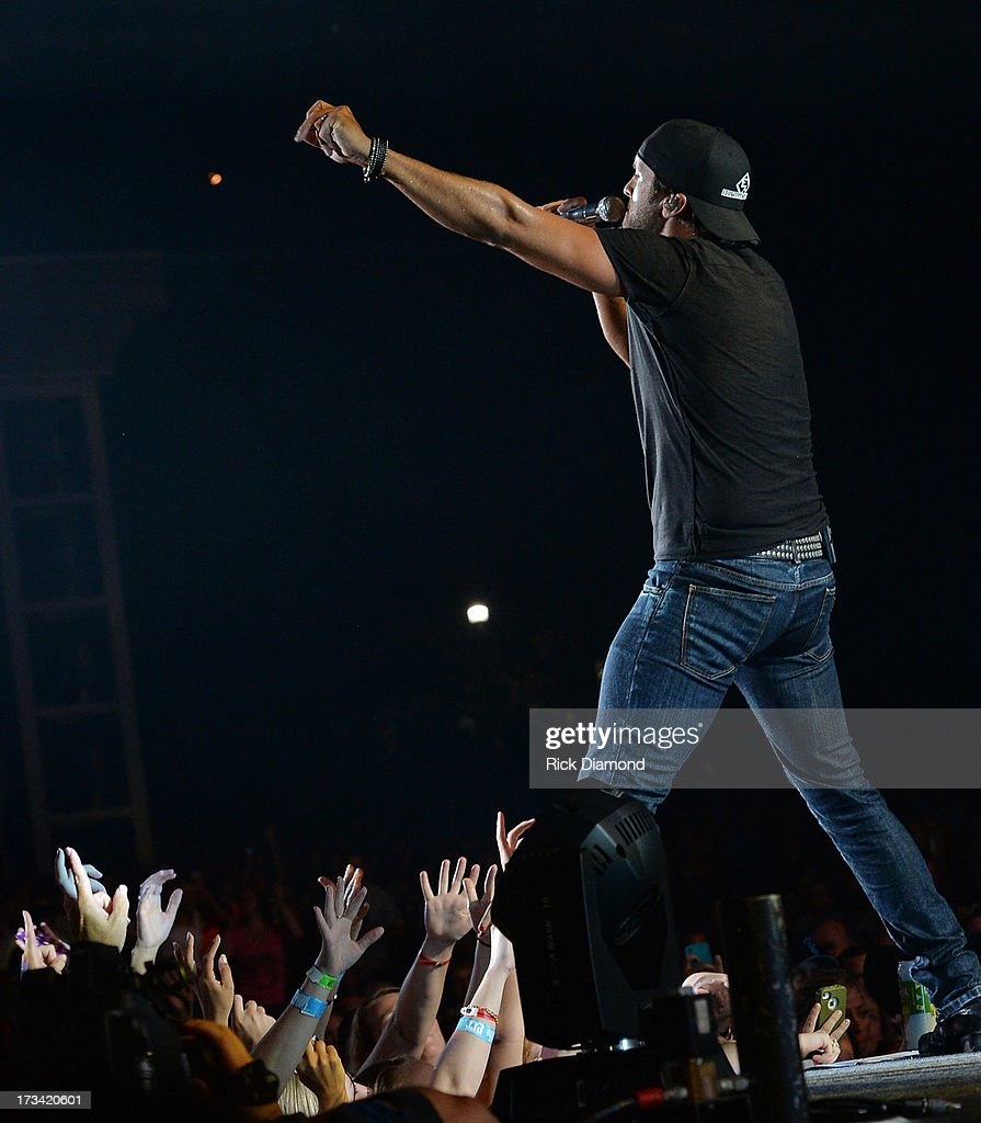 Entertainer of the Year - Singer/Songwriter Luke Bryan performs during the Dirt Road Diaries Tour 2013 on July 13, 2013 at Time Warner Cable Music Pavilion in Raleigh, North Carolina.