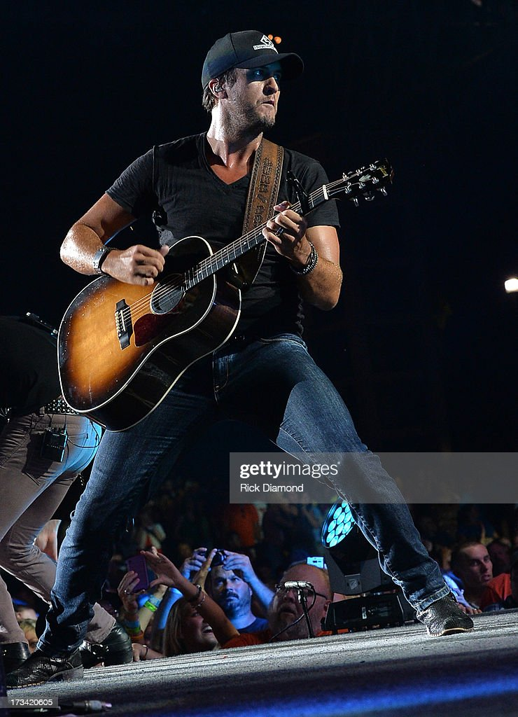 Entertainer of the Year - Singer/Songwriter <a gi-track='captionPersonalityLinkClicked' href=/galleries/search?phrase=Luke+Bryan&family=editorial&specificpeople=4001956 ng-click='$event.stopPropagation()'>Luke Bryan</a> performs during the Dirt Road Diaries Tour 2013 on July 13, 2013 at Time Warner Cable Music Pavilion in Raleigh, North Carolina.