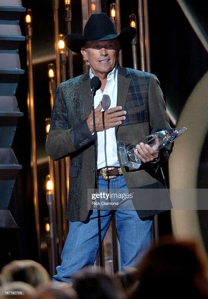 Entertainer of the Year winner <a gi-track='captionPersonalityLinkClicked' href=/galleries/search?phrase=George+Strait&family=editorial&specificpeople=234588 ng-click='$event.stopPropagation()'>George Strait</a> speaks onstage during the 47th annual CMA Awards at the Bridgestone Arena on November 6, 2013 in Nashville, Tennessee.