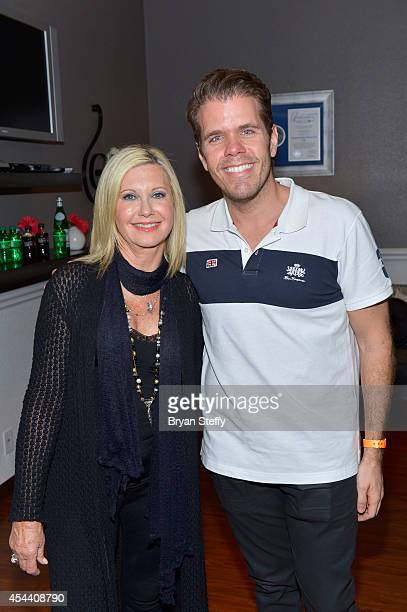 Entertainer Olivia NewtonJohn and blogger/television personality Perez Hilton pose for a photo after he attended her show 'Summer Nights' at Flamingo...