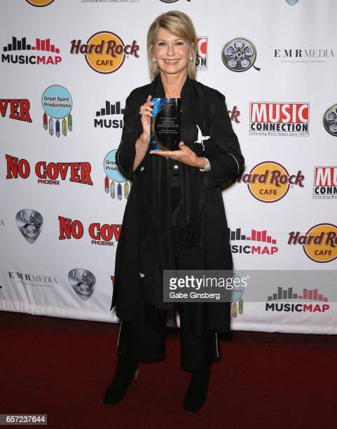 Entertainer Olivia NewtonJohn recipient of the Las Vegas Icon award poses with her trophy during the inaugural Las Vegas FAME Awards presented by the...