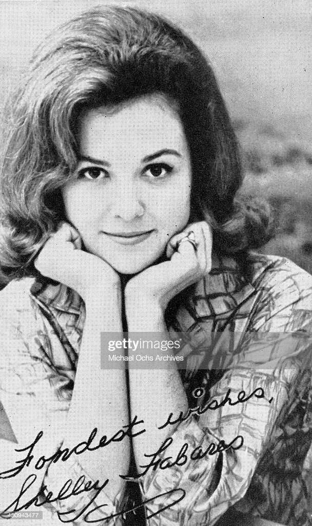 Entertainer Shelley Fabares poses for a portarit on a autographed postcard in circa 1960