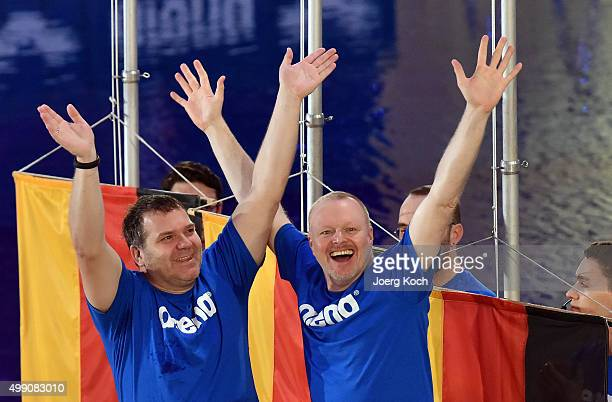 Entertainer Stefan Raab and entertainer Elton celebrate their 3rd place during the TV show 'TV Total Turmspringen' on November 28 2015 in Munich...