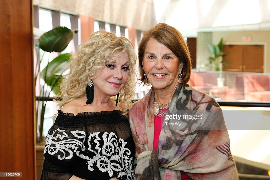 Entertainer Stella Parton and Patricia R. Miller co-founder of Vera Bradley attends Stella Parton's Red Tent Women's Conference 2014 at the Doubletree Hotel Downtown on April 19, 2014 in Nashville, Tennessee.