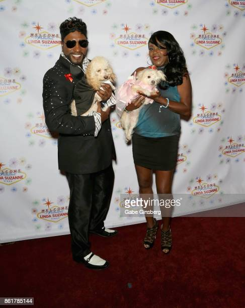 Entertainer Tyrone 'TFox' Fox and his wife Imani Fox pose with rescue dogs from Friends for Life Humane Society at the debut of 'Linda Suzanne Sings...