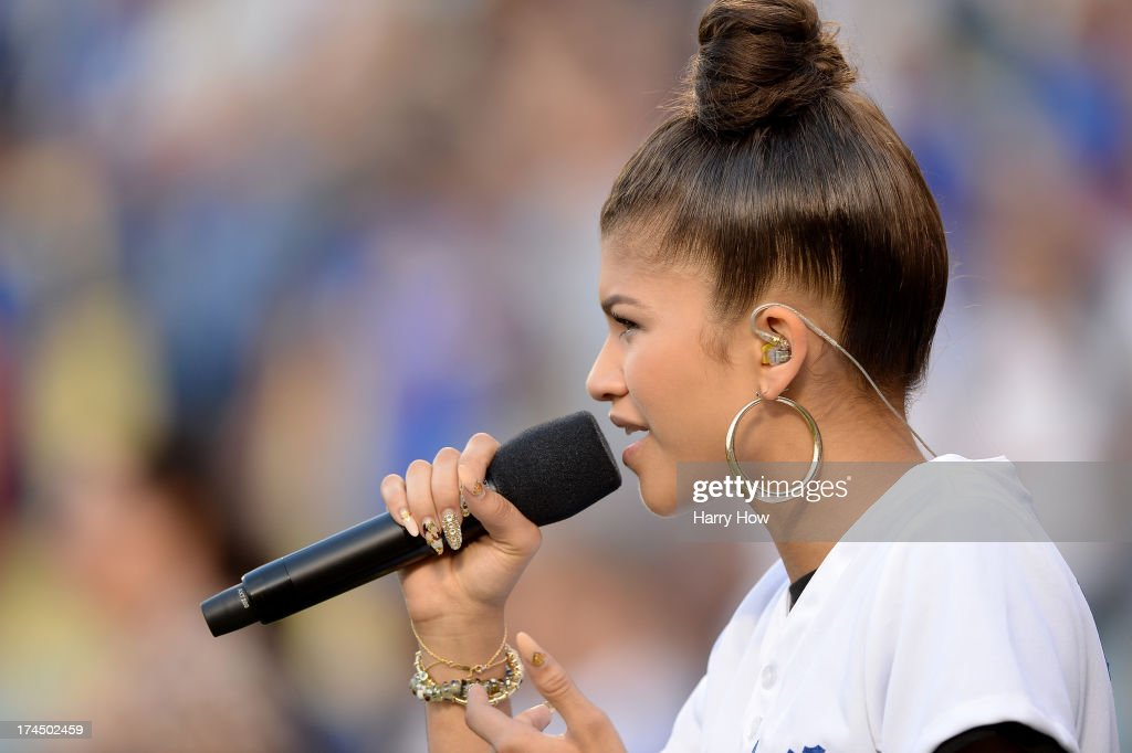 Entertainer Zendaya sings the National Anthem before the game between the Cincinnati Reds and the Los Angeles Dodgers at Dodger Stadium on July 26, 2013 in Los Angeles, California.