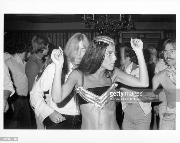 Entertainers and celebrity couple Gregg Allman and Cher attend a party in honor of the Doobie Brothers on May 2 1975 in Los Angeles California