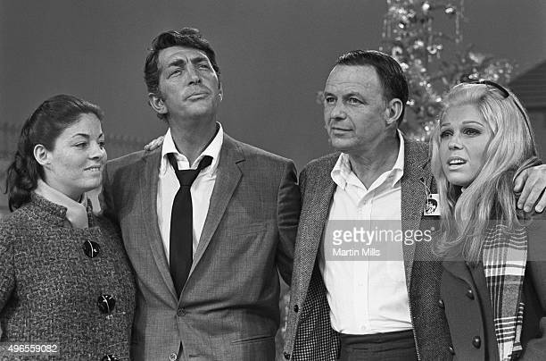 Entertainers Dean Martin and Frank Sinatra with daughters Deana Martin and Nancy Sinatra on the set of 'The Dean Martin Show' Christmas special in...