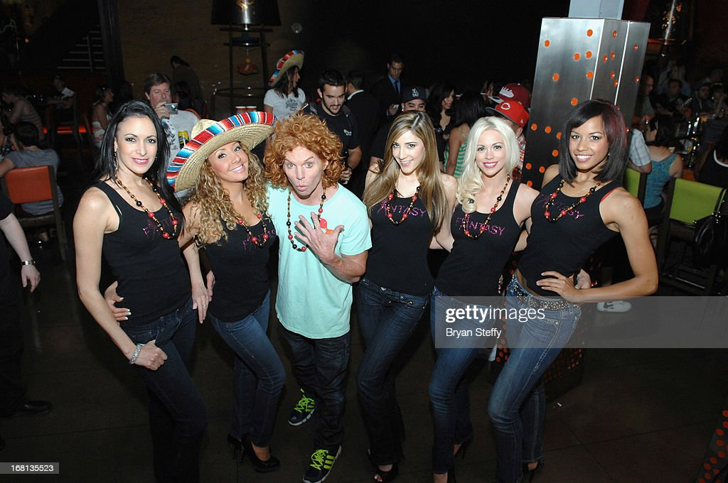 Entertainers from the 'Fantasy' show Yesi, Lorena Peril and comedian Carrot Top and Soolin, Chloe Louise Crawford and Aston appear at Tacos & Tequila's Cinco de Mayo celebration at the Luxor Resort & Casino on May 5, 2013 in Las Vegas, Nevada.