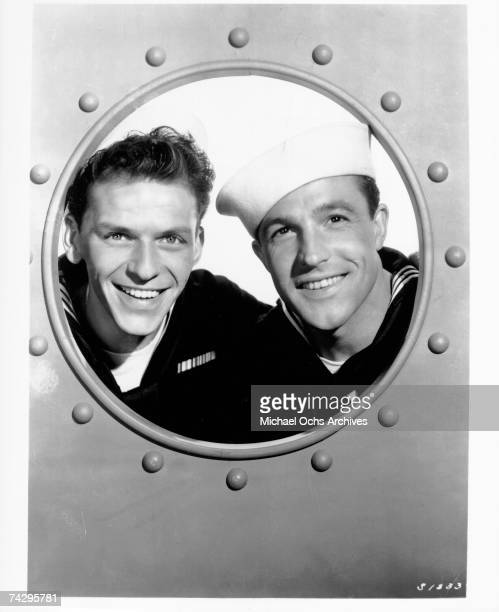 Entertainers Gene Kelly and Frank Sinatra pose for a portrait wearing sailor suits in a still from the movie 'Anchors Aweigh' which was released on...