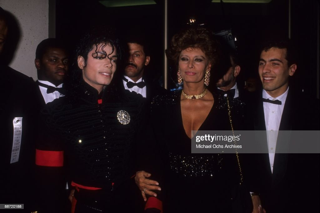 Entertainers <a gi-track='captionPersonalityLinkClicked' href=/galleries/search?phrase=Michael+Jackson&family=editorial&specificpeople=70011 ng-click='$event.stopPropagation()'>Michael Jackson</a>, <a gi-track='captionPersonalityLinkClicked' href=/galleries/search?phrase=Sophia+Loren&family=editorial&specificpeople=94097 ng-click='$event.stopPropagation()'>Sophia Loren</a> and Carlo Ponti, Jr. attend an event in circa 1990.