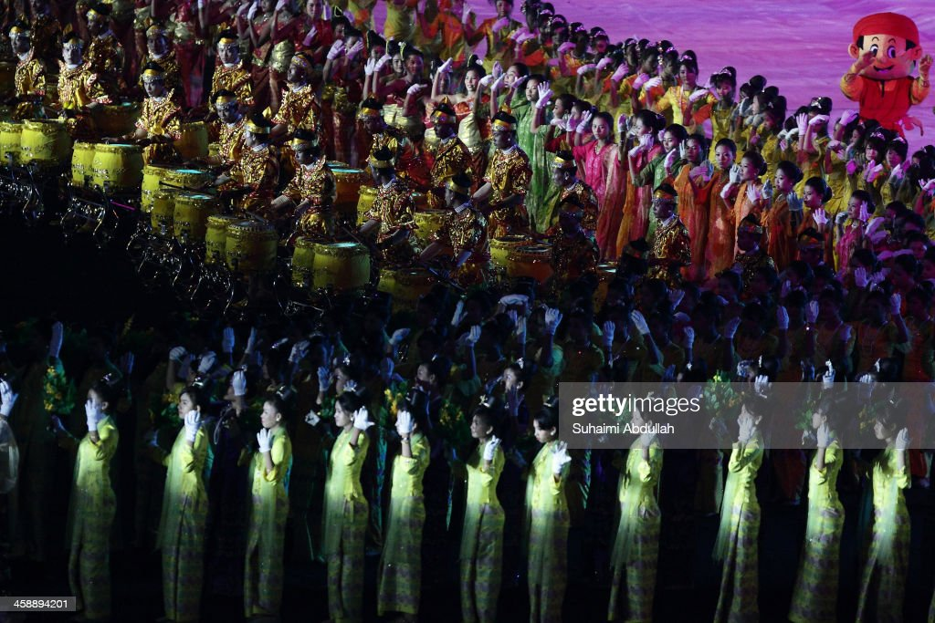 Entertainers perform during the Closing Ceremony of the 2013 Southeast Asian Games at Wunna Theikdi Stadium on December 22, 2013 in Nay Pyi Taw, Burma.