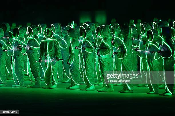 Entertainers perform on stage during the National Day Parade at Padang on August 9 2015 in Singapore Singapore is celebrating her 50th year of...