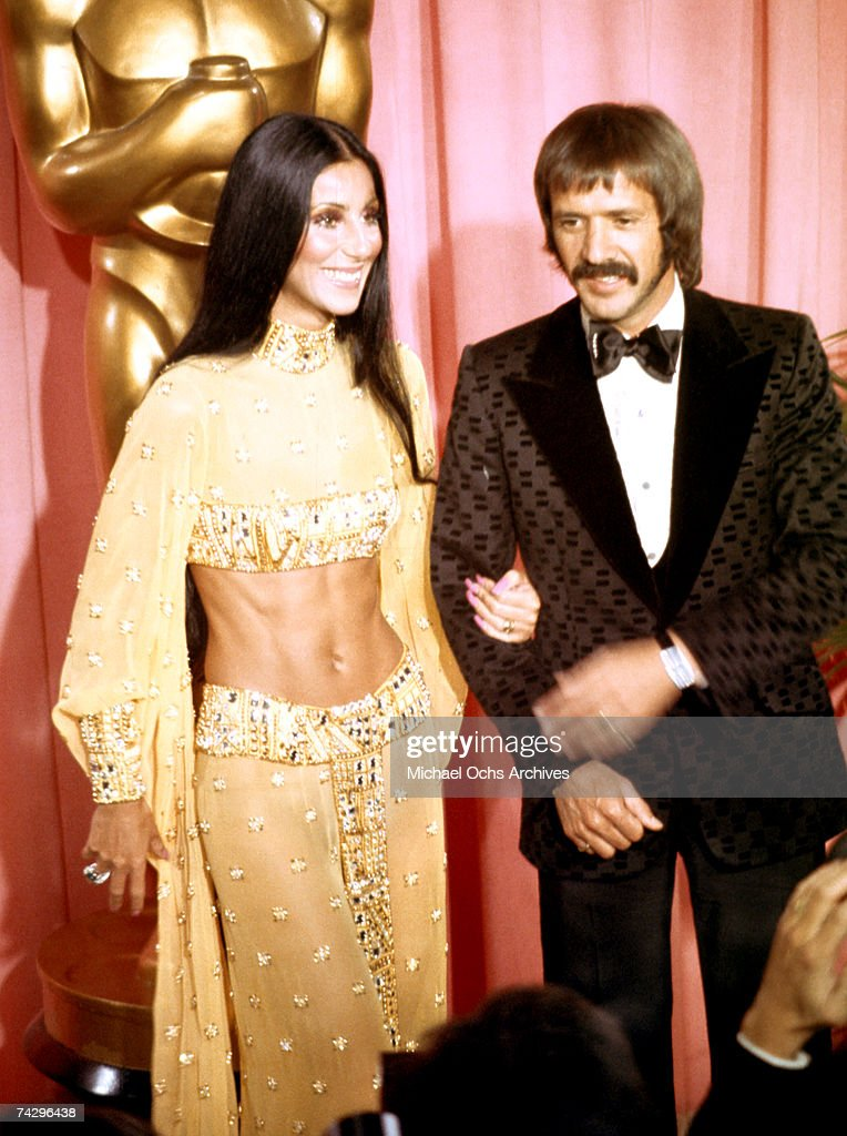 Entertainers Sonny Bono and Cher attend the Academy Awards ceremony at the Dorothy Chandler Pavilion on March 27 1973 in Los Angeles California