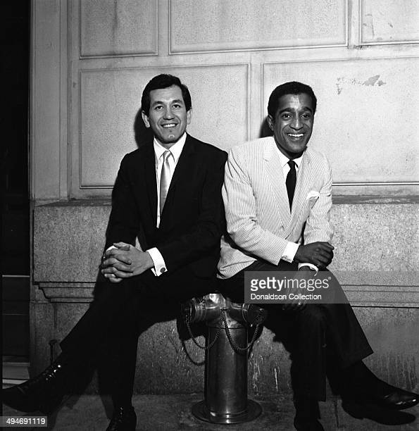 Entertainers Trini Lopez and Sammy Davis Jr pose for a portrait at a party at Shepheard's Nightclub in the Drake Hotel on May 27 1964 in New York New...