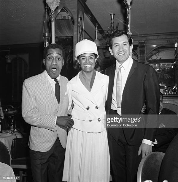 Entertainers Trini Lopez Barbara McNair and Sammy Davis Jr pose for a portrait at a party at Shepheard's Nightclub in the Drake Hotel on May 27 1964...