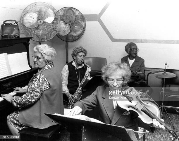 NOTES entertaining at the nutrition center Left to right Irene Riddle Dorothy Oblock Hilda Dreesen Evelyn Haley Credit The Denver Post