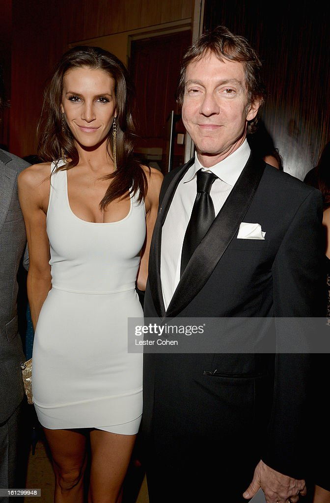 Entertainment attorney John Branca (R) and guest arrive at the 55th Annual GRAMMY Awards Pre-GRAMMY Gala and Salute to Industry Icons honoring L.A. Reid held at The Beverly Hilton on February 9, 2013 in Los Angeles, California.