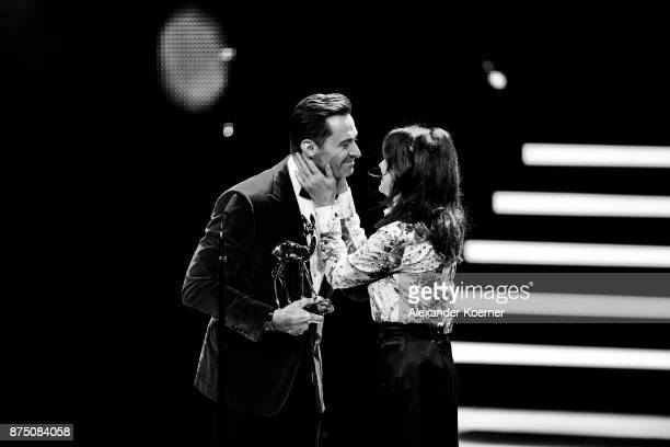 'Entertainment' Award Winner Hugh Jackman and Iris Berben on stage during the Bambi Awards 2017 show at Stage Theater on November 16 2017 in Berlin...