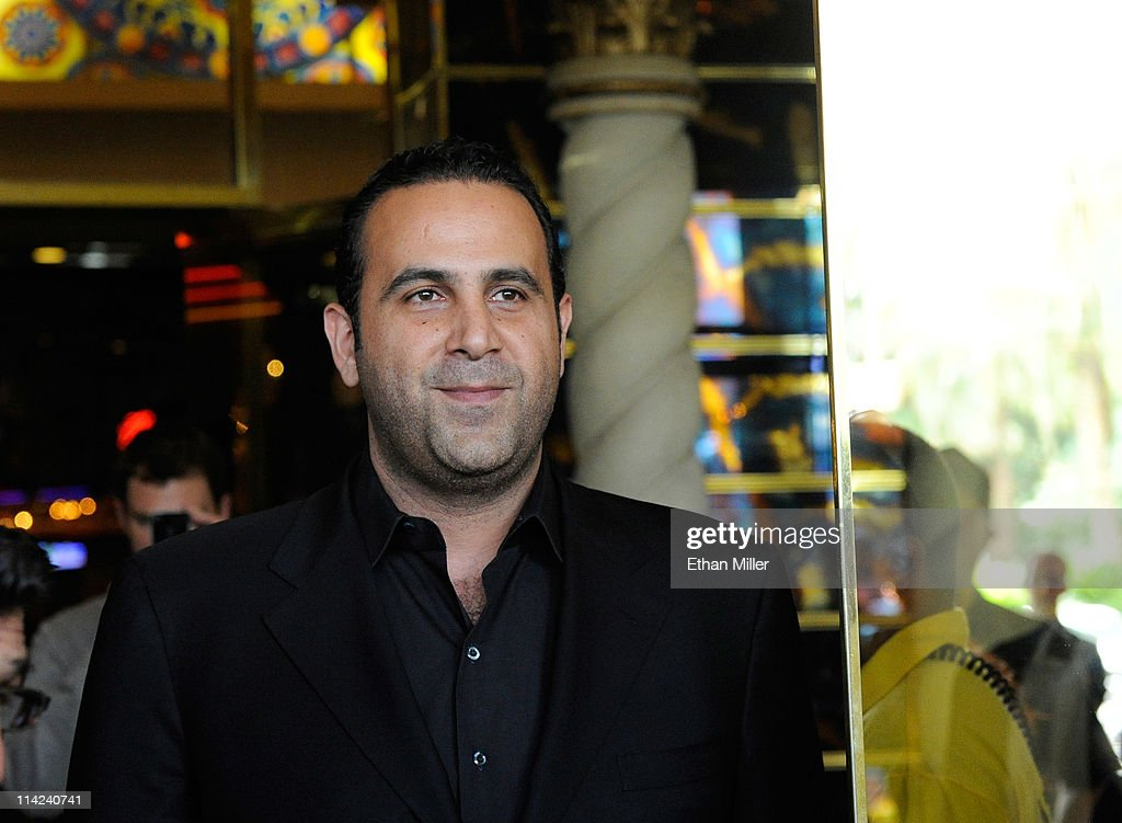Entertainment Group CEO <a gi-track='captionPersonalityLinkClicked' href=/galleries/search?phrase=Sam+Nazarian&family=editorial&specificpeople=657664 ng-click='$event.stopPropagation()'>Sam Nazarian</a> looks out the front door of the Sahara Hotel & Casino moments before closing the property on May 16, 2011 in Las Vegas, Nevada. The Sahara's current owner SBE Entertainment Group closed the 1,720-room resort, which first opened in 1952, and plans to redevelop the site in the future.