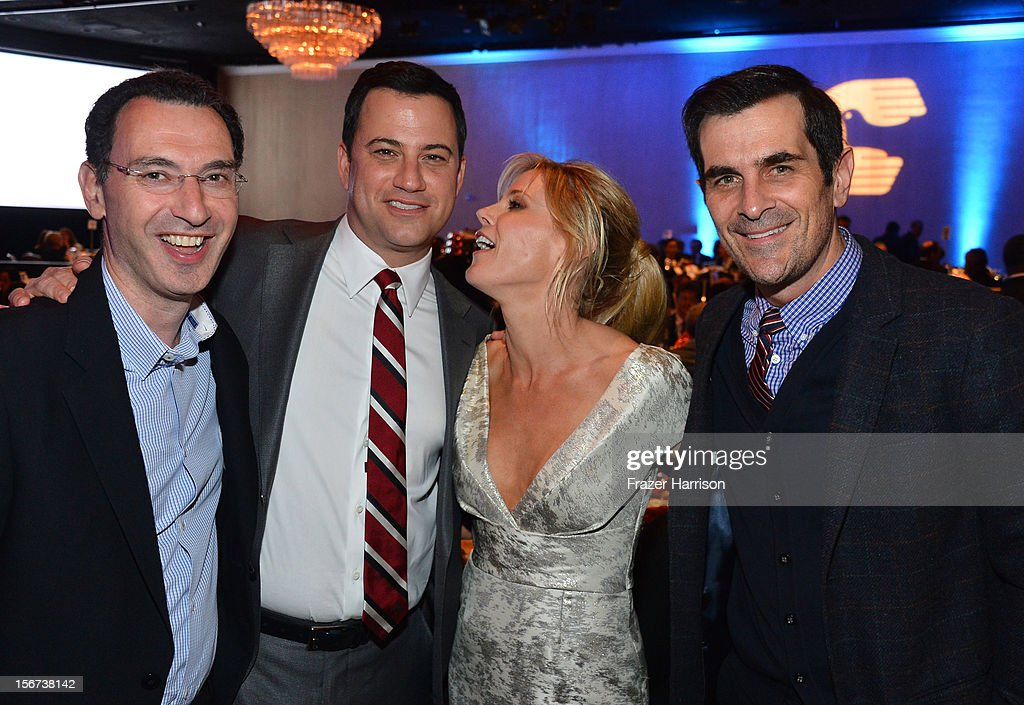 ABC Entertainment Group President Paul Lee, comedian Jimmy Kimmell, actors Julia Bowen and Ty Burrell attend The Saban Free Clinic's Gala Honoring ABC Entertainment Group President Paul Lee And Bob Broder at The Beverly Hilton Hotel on November 19, 2012 in Beverly Hills, California.