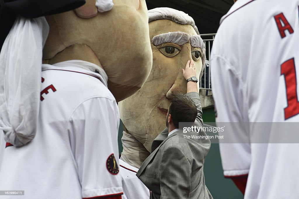 Entertainment manager for Nationals Park, Tom Davis (center) swipes away dirt from Tom's nose after the Racing President toppled over during a race against his rivals George (left) and Abe (right) as Washington Nationals fans audition to become the next Racing President at Nationals Park in Washington, D.C. on March 02, 2013. Candidates are competing for a chance to fill the shoes of Presidents George Washington, Thomas Jefferson, Abraham Lincoln, Theodore Roosevelt and William Howard Taft. Candidates perform freestyle dance, run a 40-yard dash and run two Presidents Races from center field to the home dugout. Developed in 2006, the Racing Presidents are 12 foot oversized mascots who compete in the GEICO Presidents Race during the fourth inning of every Nationals home game.
