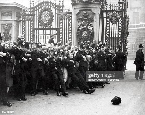 Entertainment Music Buckingham Palace London 26th October 1965 A Police helmet lies on the ground where it fell Behind it a line of policemen strain...