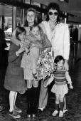 12th April 1973 London Beatle Paul McCartney and his wife Linda with their children Stella aged 1 Mary aged 3 Heather aged 10 prior to leaving for a...