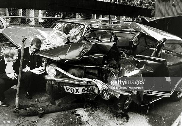 Entertainment Personalities Accidents pic 16th September 1977 Police specialists inspect the badly damaged Mini car in which pop singer Marc Bolan of...