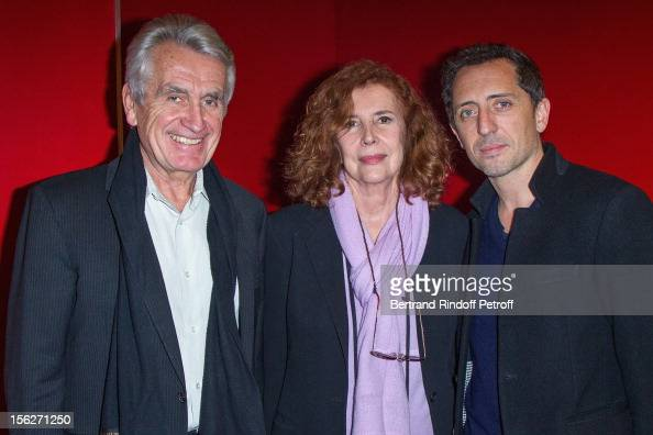 Entertainment producer Gilbert Coullier movie producer Michele RayGavras and actor Gad Elmaleh attend 'Le Capital' premiere at Gaumont Parnasse on...