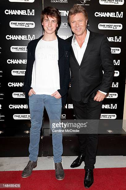 Entertainment Reporter Richard Wilkins and son Adam arrive at the Entertainment Quarter for Justin Bieber's exclusive acoustic concert on July 17...