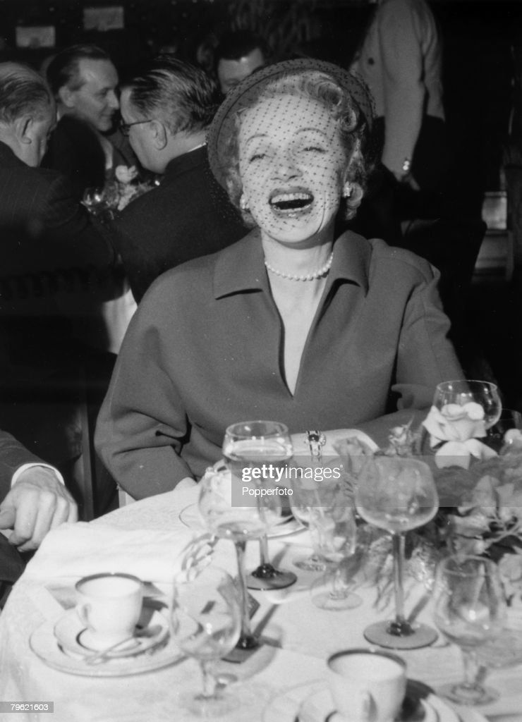 June 1954, Film star Marlene Dietrich enjoying herself at a luncheon party for the press at the Cafe de Paris, London