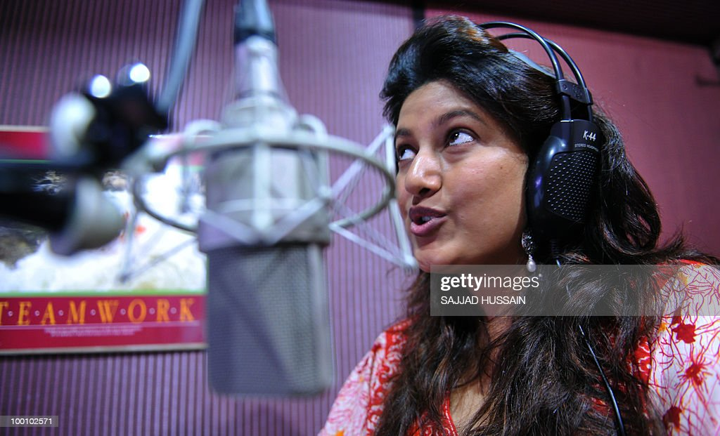 Entertainment-India-film-industry-US-Hollywood,FEATURE by Phil Hazlewood Indian voice artiste Mona Shetty rehearses the Hindi-language script for a Hollywood movie in Mumbai on May 12, 2010. The dubbing business is taking off in India with the increasing popularity of Hollywood films among domestic audiences, with analysts seeing it as a key emerging market for US films. Shetty, who runs a dubbing studio with her mother in the north of India's entertainment capital, has given her voice to some of Hollywood's most bankable female stars, like Angelina Jolie, Drew Barrymore, Cameron Diaz and Catherine Zeta-Jones. AFP PHOTO/Sajjad HUSSAIN