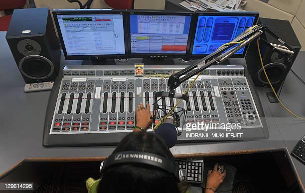 EntertainmentIndiamediaradioFOCUS by Phil Hazlewood Radio jockey Lavanya Padmanabhan hosts her show at the 927 Big FM studio in Mumbai on October 14...