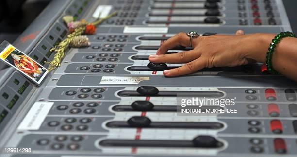 EntertainmentIndiamediaradioFOCUS by Phil Hazlewood Radio jockey Lavanya Padmanabhan works the controls as she hosts her show at the 927 Big FM...