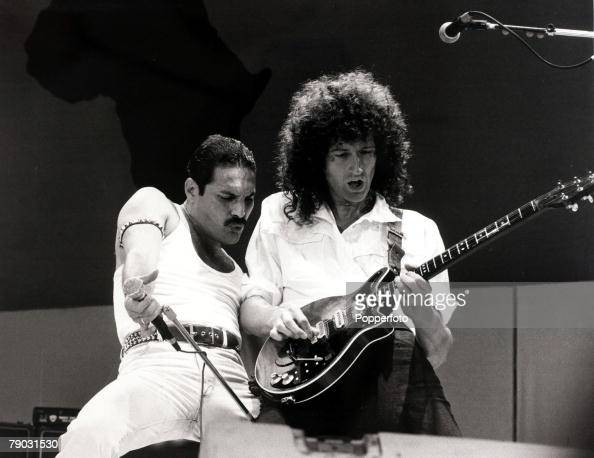 Entertainment/Music Live Aid Concert Wembley London England 13th July 1985 British singer Freddie Mercury with guitarist Brian May as 'Queen' perform...