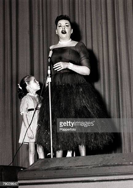 Entertainment/Music London England 19th October 1957 American entertainer Judy Garland singing at the Dominion Theatre watched by her 4 year old...
