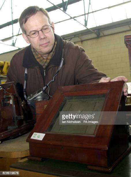 Enthusiast Peter Walker examines a Single Needle Henley's Telegraph dated 1856 which forms part of a lot in an auction of memorabilia by BT's...