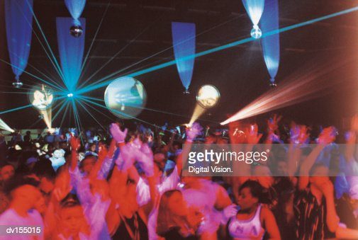 Enthusiastic crowd dancing : Stock Photo